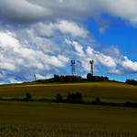 10. August 2015 - 17:41 - Tech bit: this is a stitch of three exposures.  I have walked past this mobile phone mast hundreds of times, but on this day when I saw the sun hitting the top, making it look like the all-seeing eye, a thought struck me.  It seems wonderfully appropriate (and ironic) that these structures are sited at the highest point for miles around, like some object of ritual adulation for 21st Century homosapiens. After all, we are hopelessly enthralled with our mobile 'communications' devices; complete access, complete availability, regardless of time, place or context.  I might even organise a vigil at the Midwinter Solstice, in the hope of  receiving  a sign at midnight by synchronised text with an attached link......  Here endeth the grump. Hands up anyone reading this on a mobile device :)
