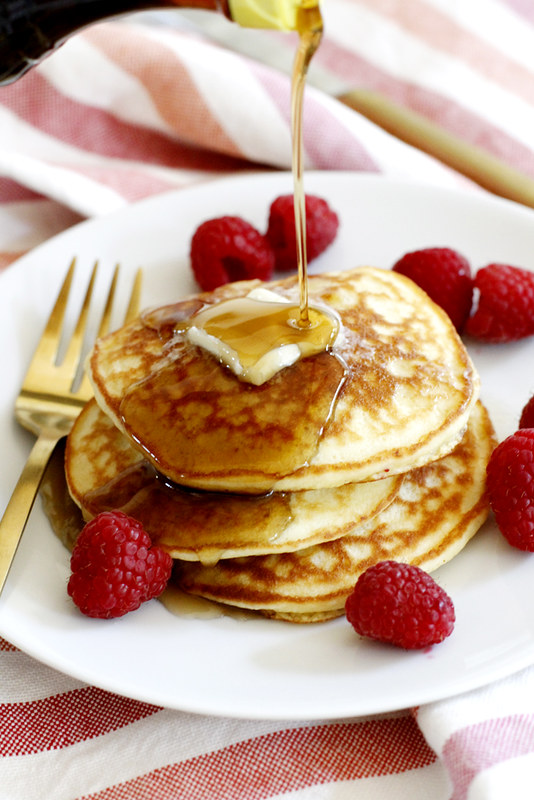 Fluffy Coconut Flour Pancakes -- this simple and deliciously fluffy coconut flour pancakes recipe is gluten free and begging to be your next breakfast. girlversusdough.com @girlversusdough #girlversusdough