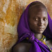 Suri Woman in Purple by John Rowe Photo
