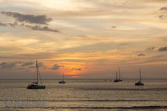 Sunset with yachts and catamarans at Nai Harn beach, Phuket, Thailand         XOKA8998bs
