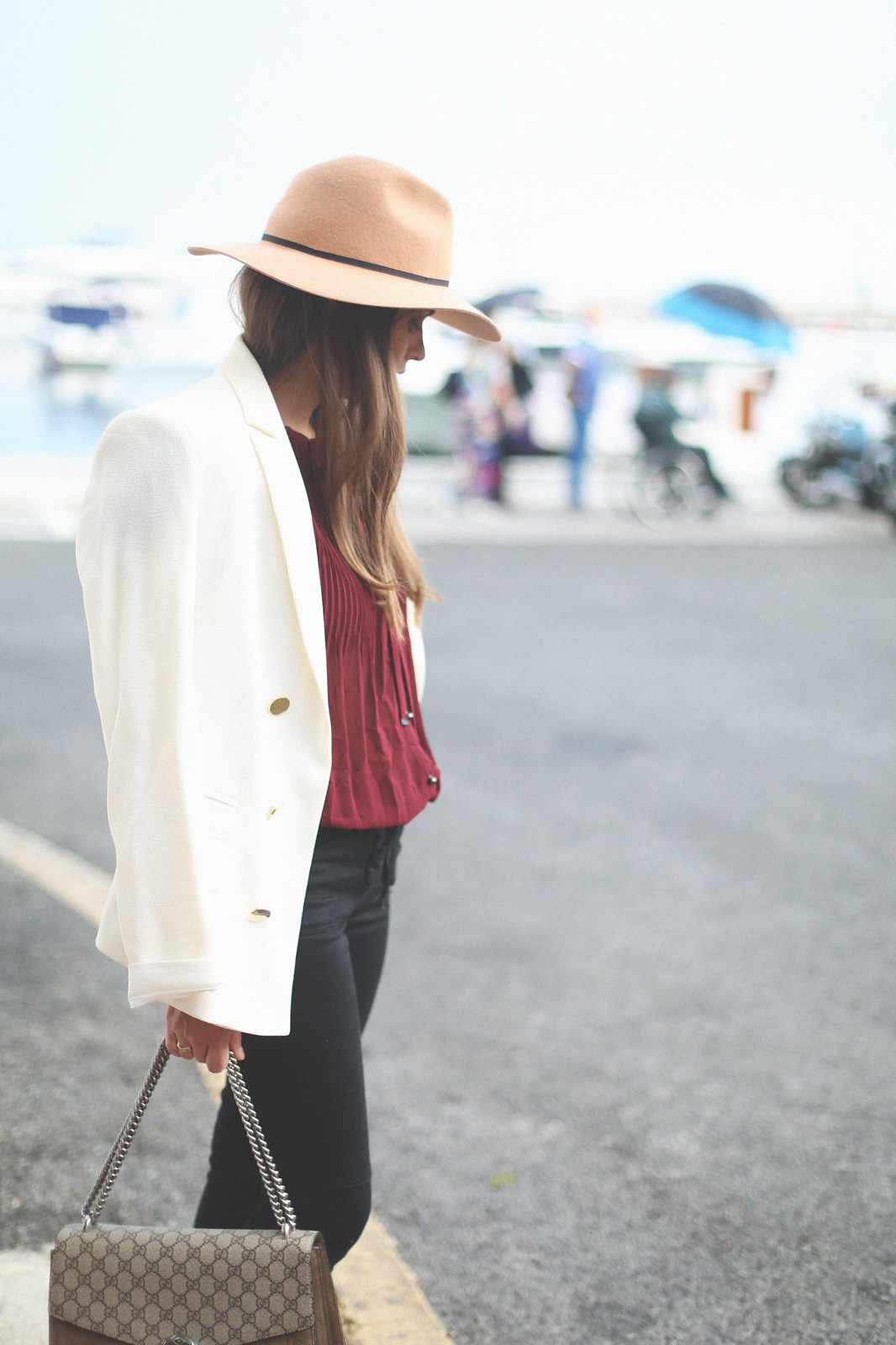 10. jessie chanes burgundy blouse cropped black jeans gucci bag