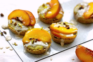 Raw peach tarts with apricot crust and pistachio creme
