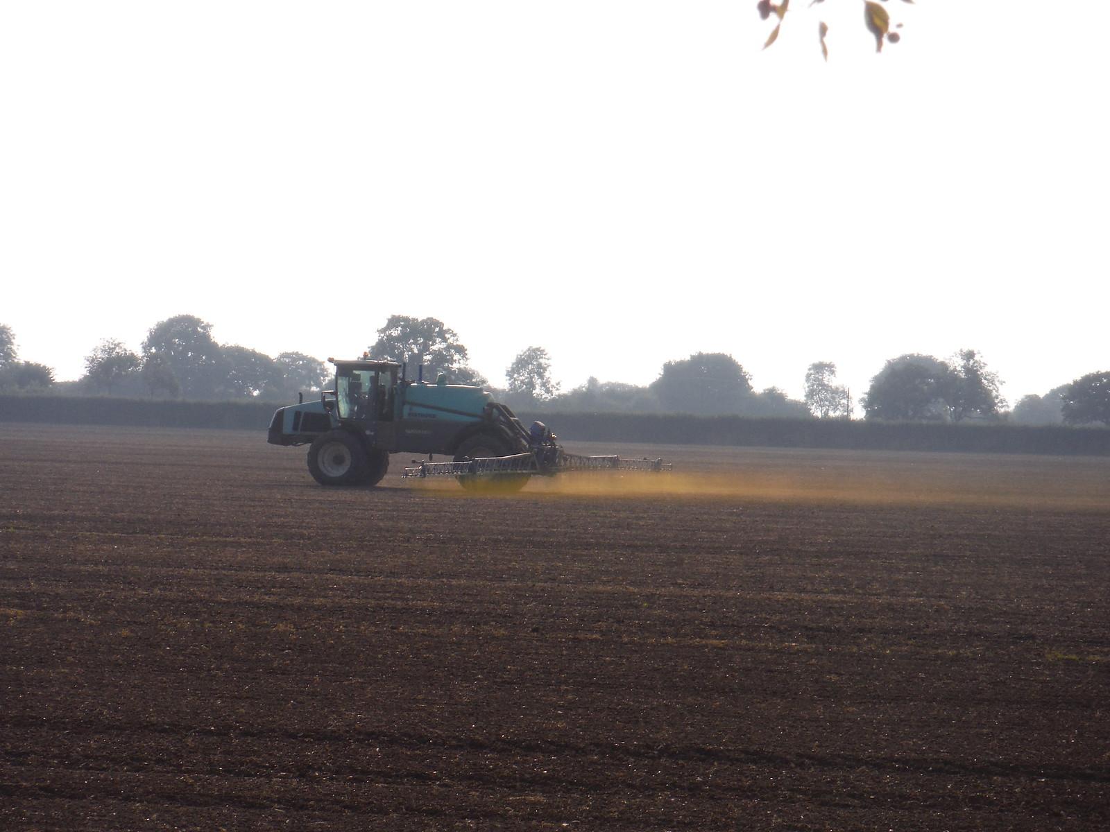Farmer spraying some green stuff SWC Walk 159 South Woodham Ferrers to North Fambridge