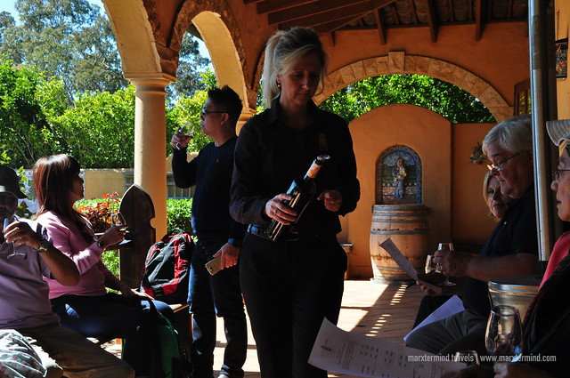 A Sommelier Pouring Wine for Tasting at Iron Gate Estate