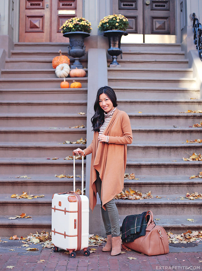 Airport travel outfit boots cardigan brics bellagio suitcase