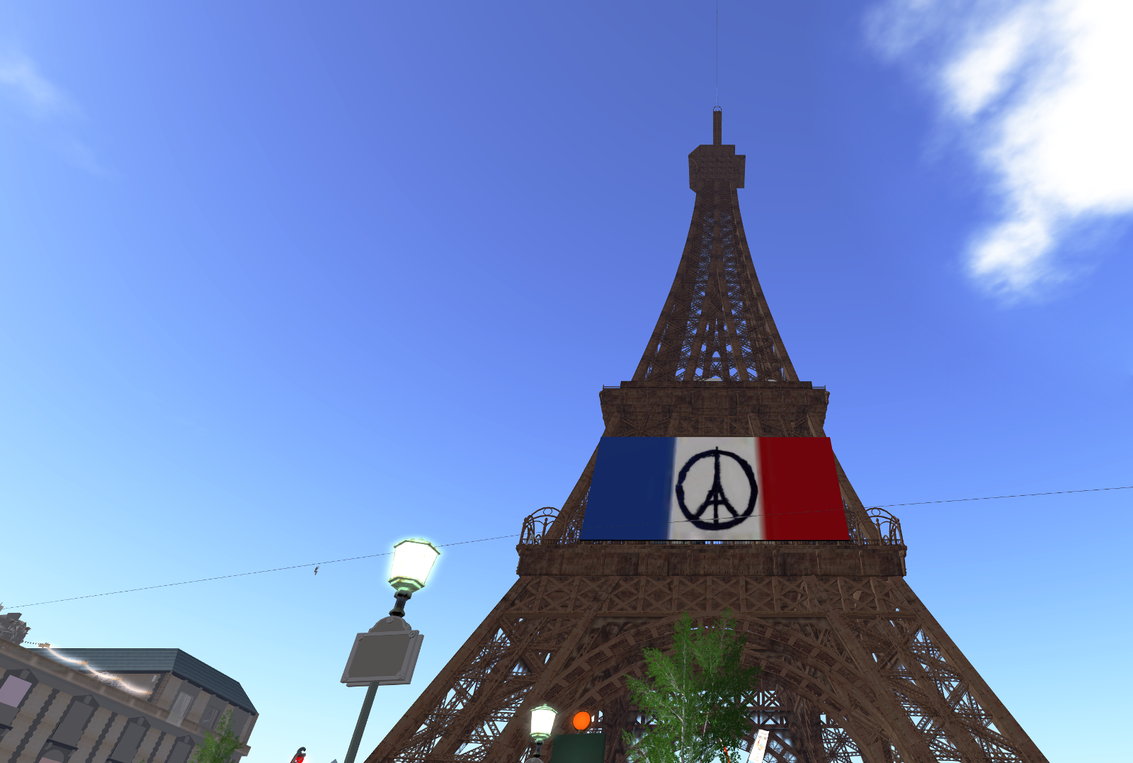 The Eiffel Tower and the Peace for Paris sign applied to the French flag