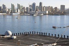 Sailors and Marines man the rails as USS Theodore Roosevelt (CVN 71) arrives in San Diego on Monday. (U.S. Navy/MCSN Chad M. Trudeau)