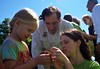 Service Director Dan Ashe helps as Hallie tags a monarch. by U.S. Fish and Wildlife Service - Midwest Region