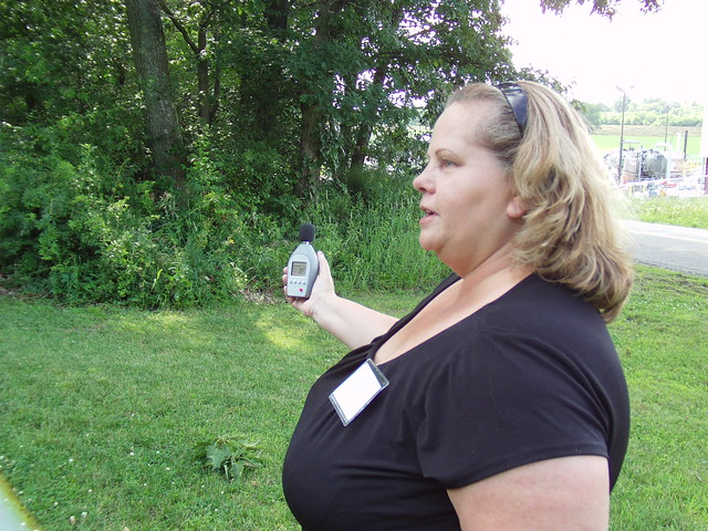 a woman holding a noise level detector