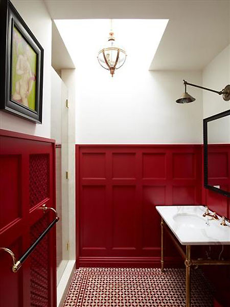red wainscotting in a powder room