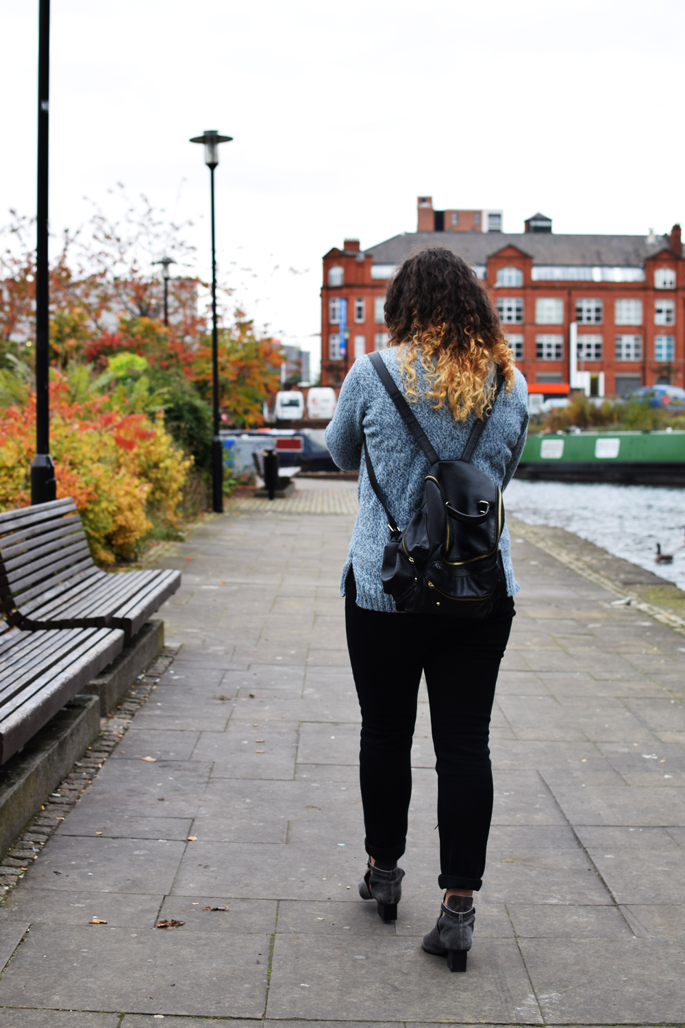 chunky knitwear and black leather rucksack street style look