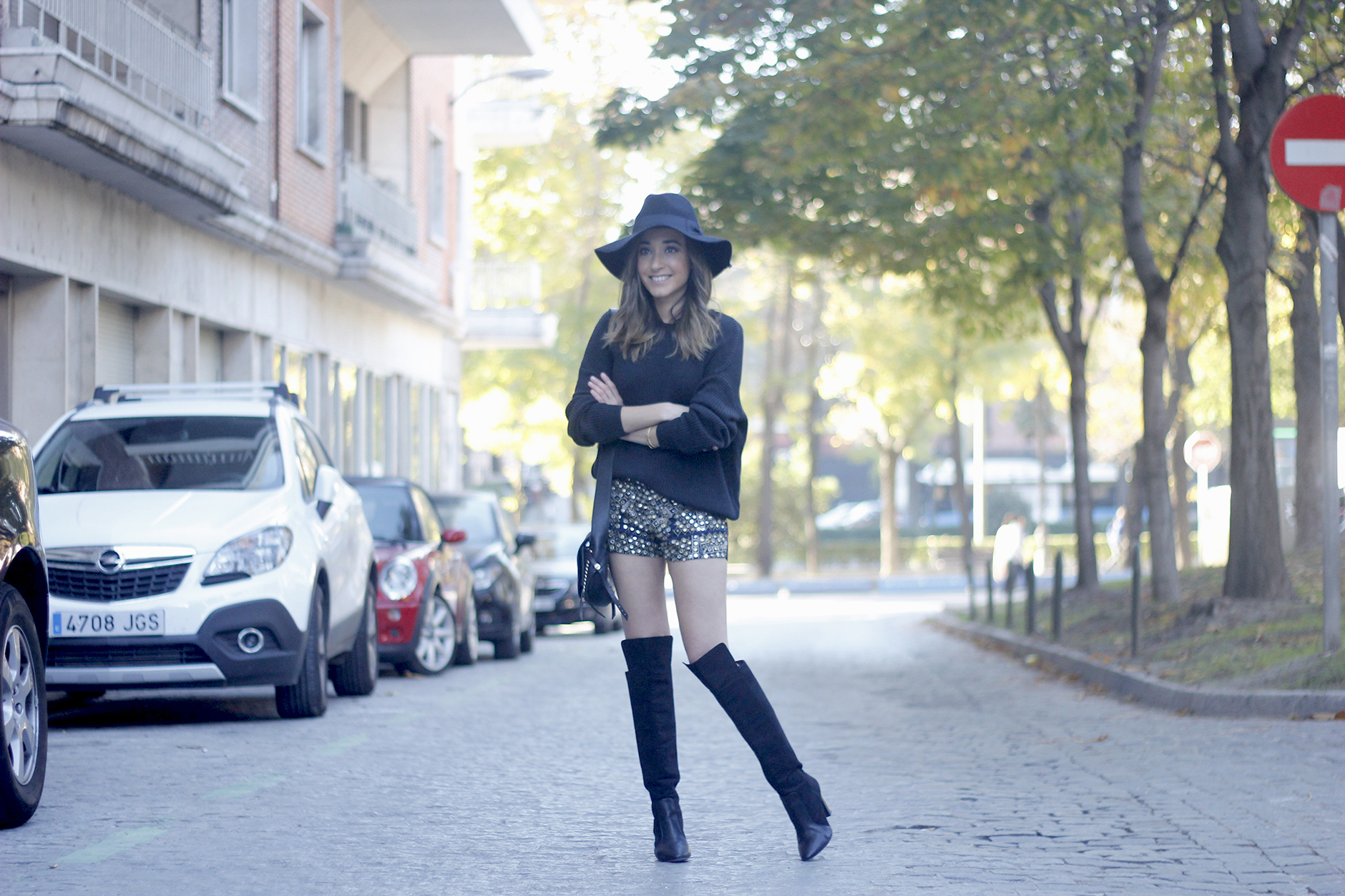 embroidered shorts black hat over the knee boots black sweater pull and bear purse coach outfit03