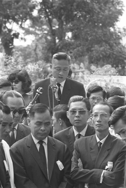 1966-12 General Tran van Don delivering funeral address. Don was leader of association of southern elites - by Francois Sully
