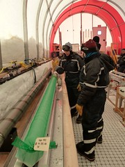 Mindy and Emma receiving a freshly drilled section of ice core