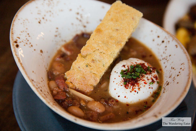 Breakfast Cassoulet - Braised Heirloom Beans, Chicken Demi, Fingerling Potatoes, House Sausages, Bentons Bacon, Poached Egg, Jalapeno and Sage Corn Bread Crouton