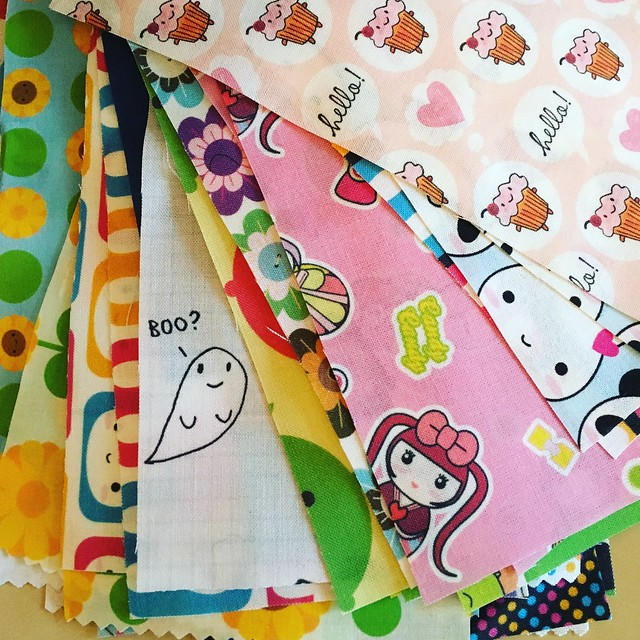 I've been cutting up more of my old spoonflower swatches for that quilt I'm supposedly making. It will certainly be colourful!