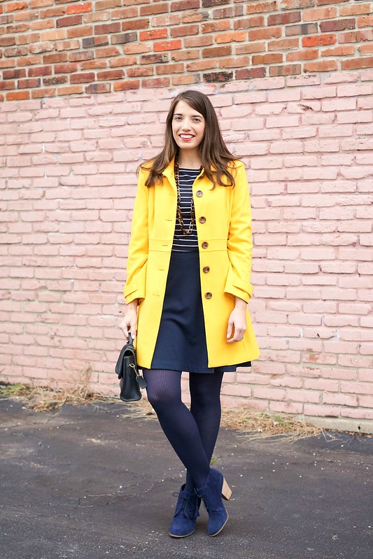 yellow Old Navy coat, navy stripe tee, navy skirt, navy tights and Sole Society tassel ankle boots