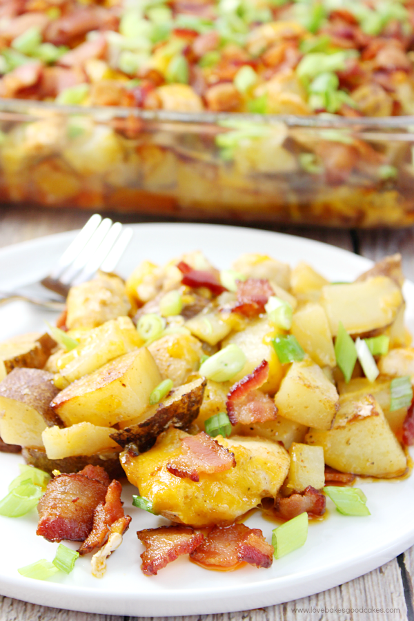 Make this Loaded Potato and Chicken Casserole tonight! Seasoned potatoes and chicken are baked together and then topped with plenty of cheese, green onions and bacon! #BaconMonth2015