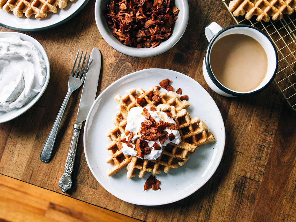 Gluten free maple waffles with coconut whipped cream + coconut bacon