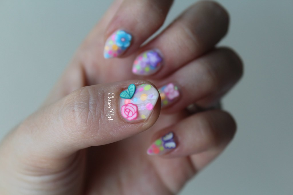 Neon polka dot nail art with fimo nail embellishments