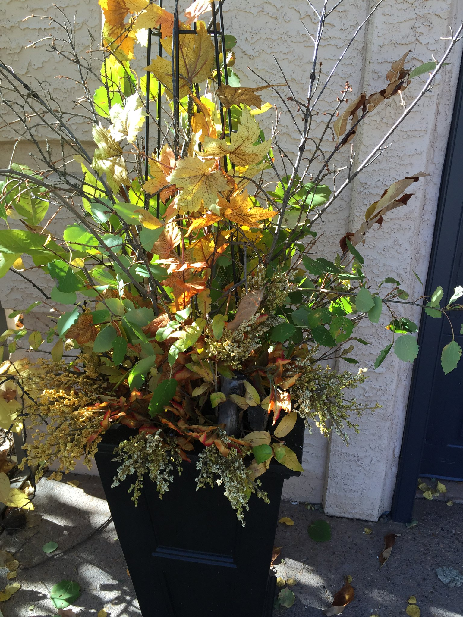 outdoor Autumn arrangement in large black urn