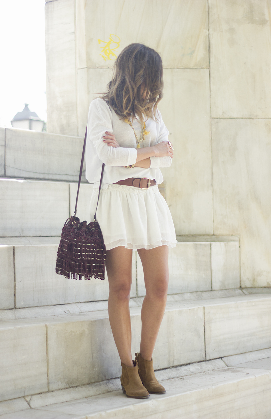 White casual outfit with brown booties and burgundy bag13