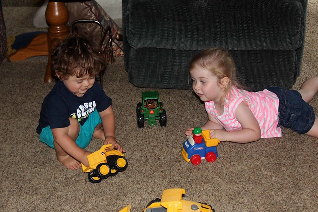 Uly and Harper playing trucks