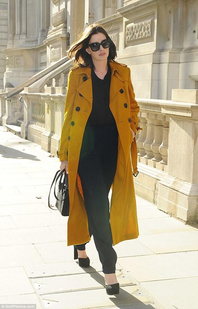 black-top-navy-blue-trousers-yellow-Burberry-trench-coat-black-platform