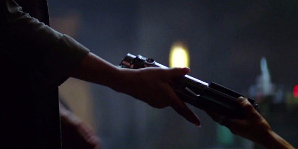 Luke Skywalker's lightsaber is handed in Star Wars: The Force Awakens.