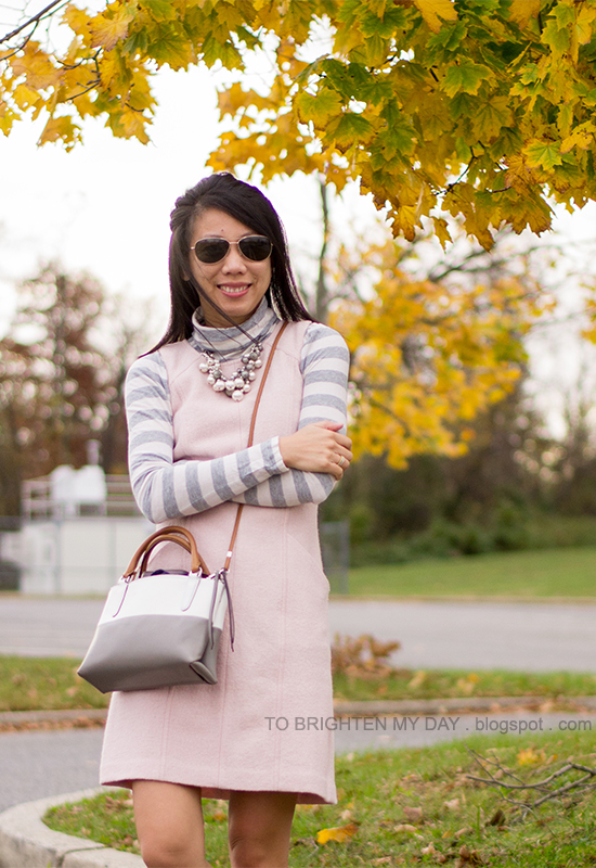 gray striped turtleneck, mixed pearl necklace, pink wool dress, colorblocked crossbody bag