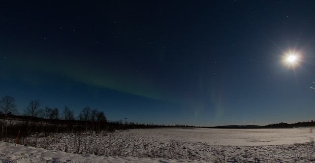 full moon and pale auroras