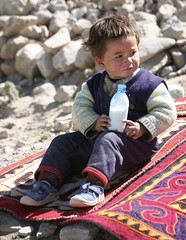 Semi Nomadic Kyrgyz Child Shyrdak Felt Rug The Karakoram Highway Landscape Xinjiang Uyghur Autonomous Region of China