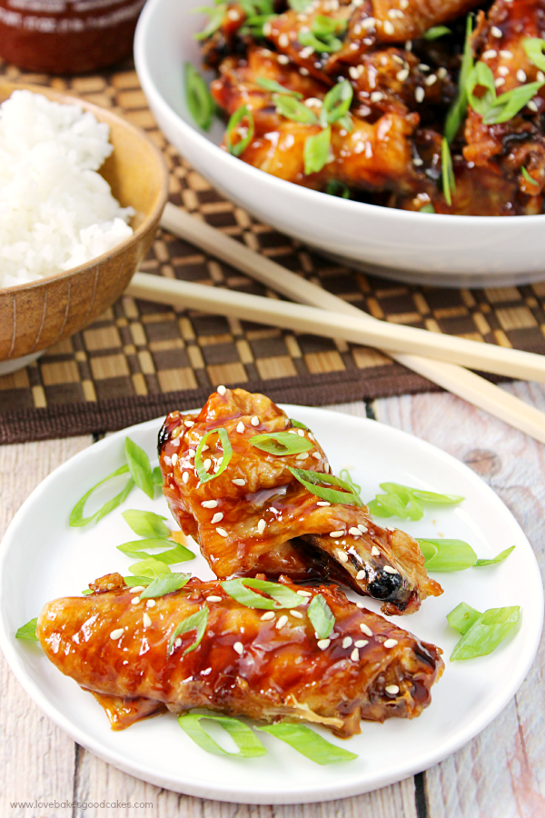 Asian Sticky Wings on a plate with white rice.