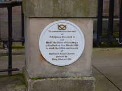 Photo of Elizabeth II and Philip Mountbatten white plaque
