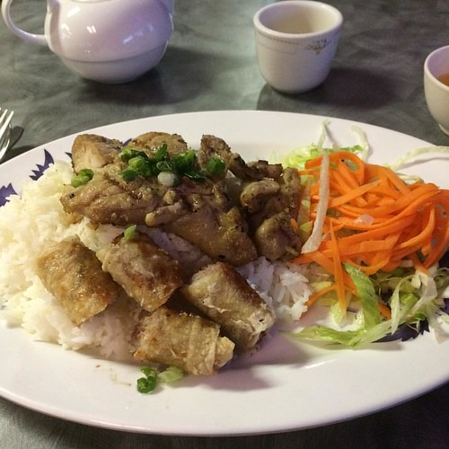 Chicken on rice with spring rolls. #yegfood