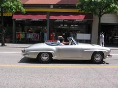 compact car(0.0), muscle car(0.0), automobile(1.0), automotive exterior(1.0), vehicle(1.0), performance car(1.0), automotive design(1.0), mercedes-benz(1.0), mercedes-benz 190sl(1.0), antique car(1.0), vintage car(1.0), land vehicle(1.0), luxury vehicle(1.0), convertible(1.0), sports car(1.0), motor vehicle(1.0),