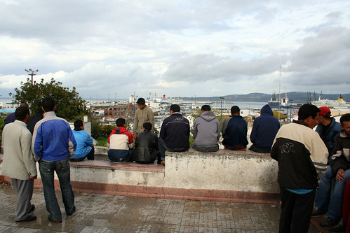 Young men in Morocco, Europe on the horizon. Photo: moritz_siebert/flickr.