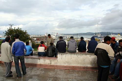 Young men in Morocco, Europe on the horizon. Photo: moritz_siebert/flickr.