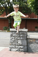little nick making a big jump down off of the wall  …