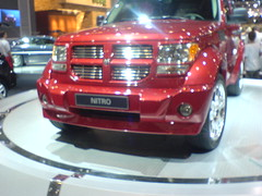 city car(0.0), compact car(0.0), automobile(1.0), automotive exterior(1.0), sport utility vehicle(1.0), dodge(1.0), dodge nitro(1.0), wheel(1.0), vehicle(1.0), rim(1.0), auto show(1.0), grille(1.0), bumper(1.0), land vehicle(1.0), luxury vehicle(1.0),