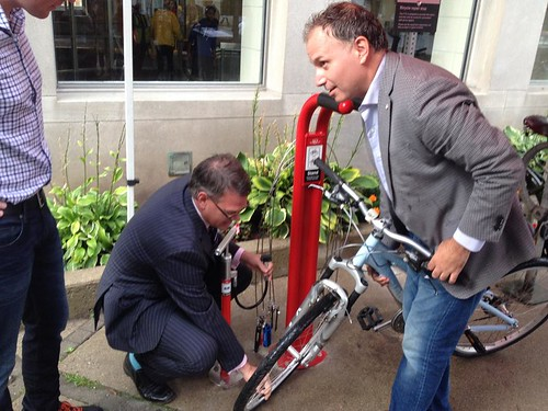 TTC Deputy CEO and Chief Customer Officer Chris Upfold and TTC Chair Josh Colle try out new bike repair stand, Davisville station, TTC, Toronto