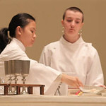 Servers at altar