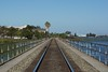 View of the rails leading towards downtown Antioch and the Amtrak Station. The bridge runs along the San Joaquin River.