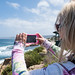 Small photo of Taking a pic of La Jolla with her phone