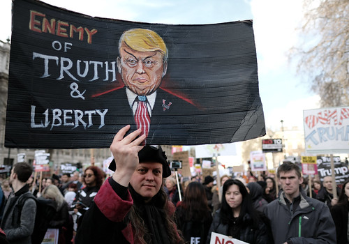 Enemy of truth and liberty - protester in Whitehall during the anti-Trump ban march in London.