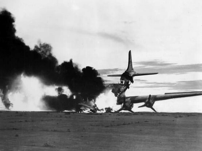 A U.S. Air Force Douglas C-54 Skymaster transport  destroyed by North Korean fighters in South Korea