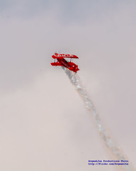 ORACLE CHALLENGER III RISING ON A PILLAR OF AIRSHOW SMOKE