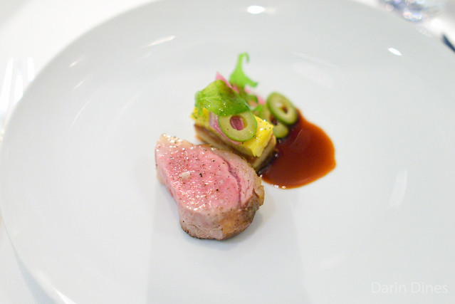 "RIB-EYE OF ELYSIAN FIELDS FARM'S LAMB ""Panisse,"" Fairy Tale Eggplant, Corn Kernels, Cerignola Olives and ""Sauce Pimentón"""