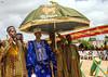 Benin, West Africa, Porto-Novo, king gbèmédô tognon zounon walking under an umbrella by Eric Lafforgue