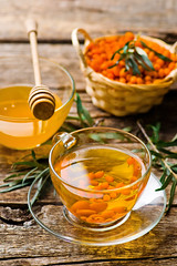 hot drink from a sea-buckthorn in a glass cup